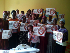 Grassroots members and allies with WGNRR campaign materials in Nigeria